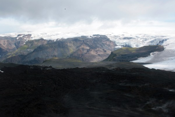 Looking from Magni across the steaming lava flow to the glaciers from Myrdalsjokull.