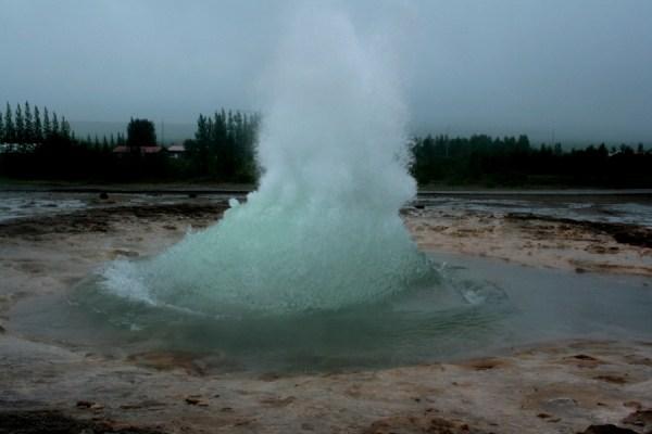 Strokkur begins an eruption.