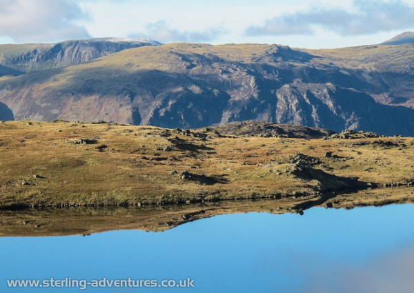 Which way is up?What an incredibly clear and still day today was.  I guess the only hint that it's been raining cats and dogs for weeks is that the Blea Tarn is indeed full!
