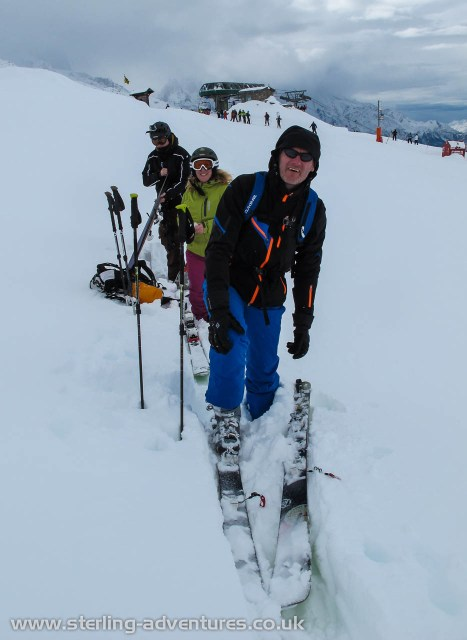 Mathias, Rebecca, and Pete getting their skins on at the top of the lift system up from Le Tour