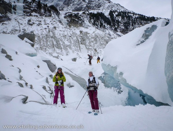 Rebecca and Laetitia skiing in to the fun ice-gully near the exit of the Mer de Glace