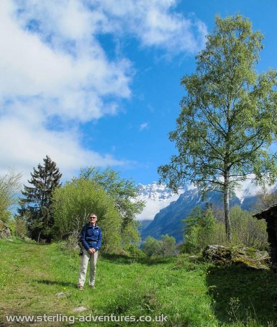 Pete walking through the meadow on the way towards Dalle a Bornet at Secteur Vallon de Van.