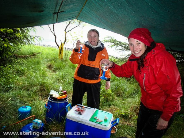After a day paddling and being soaked by the heavy rain Lisa and Laetitia feel much better thanks to a Gin & Tonic