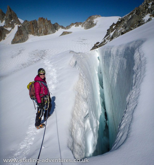 Laetitia navigating around one of the smallest of the  MASSIVE crevasses on the way back down the Glacier de l'Epaule