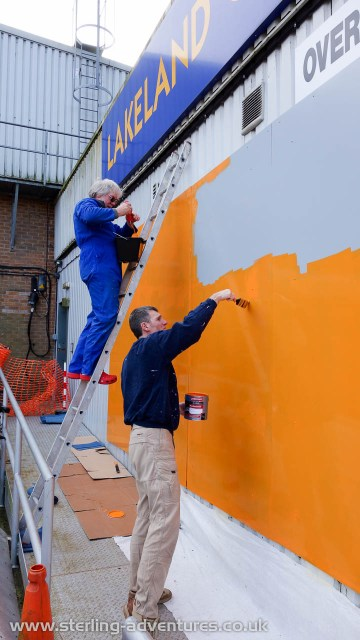 Dave Viggers and Pete Sterling applying an orange background