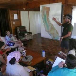 Instructor showing students where they will be camping and hiking at in California