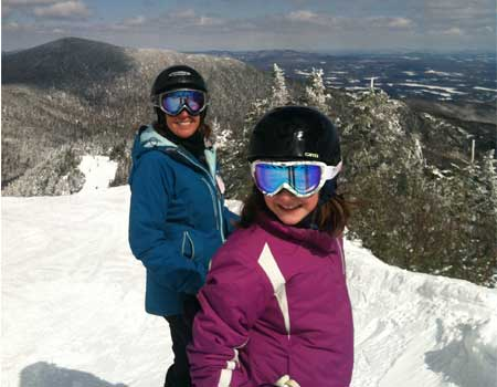 mother and daughter skiing at smugglers notch