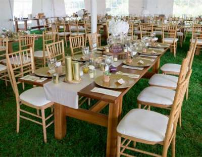 wedding tent interior with farm table set up   Sterling Ridge Resort