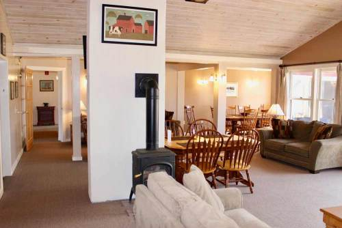 Mansfield House open living area with gas log fire
