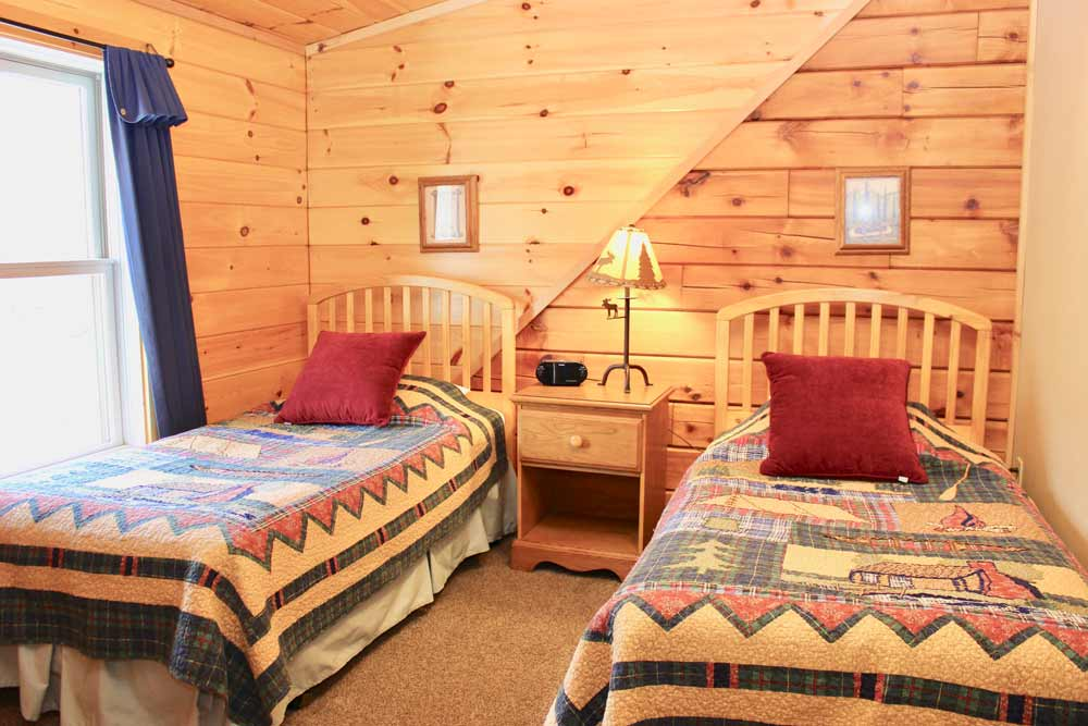 wilderness cabin twins bedroom | Sterling Ridge Resort