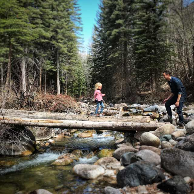Vermont log cabin fathers day - father & daughter by rocky stream