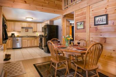 Wilderness Cabin with kitchen and dining area | Sterling Ridge Log Cabin Resort