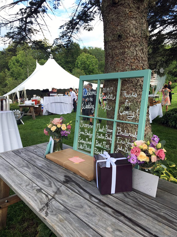 outdoor wedding reception tent at Sterling Ridge Resort in Jeffersonville Vermont