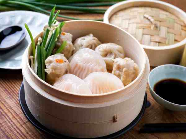 77247539 – traditional chinese dim sum as close-up on bamboo steamer
