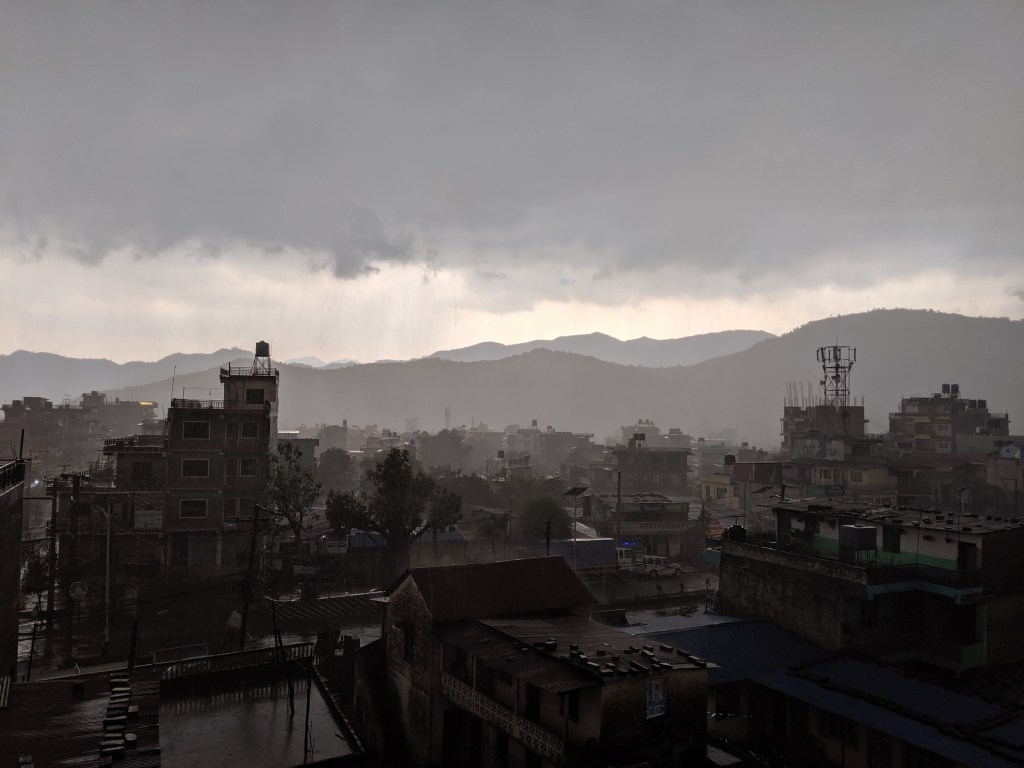 View from our balcony in Pokhara in the afternoon as the daily monsoon rolls in