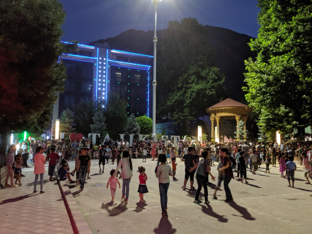 People dancing in the main square at night