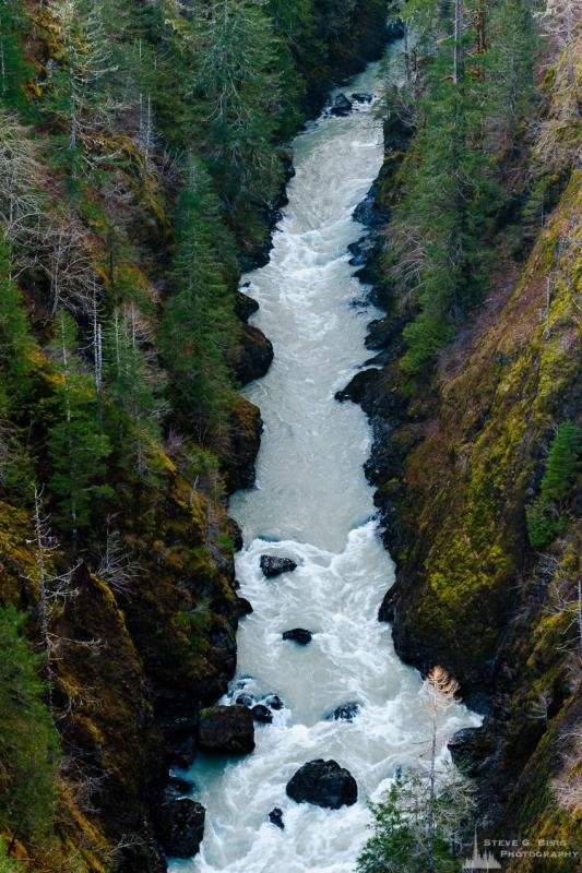 A landscape photograph of the South Fork Skokomish River as viewed upriver from the High Steel Bridge in the Olympic National Forest along FR2340 in rural Mason County, Washington.