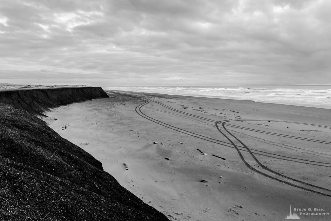 A black and white landscape photograph of the Pacific Ocean and beach at Westhaven State Park near Westport, Washington.