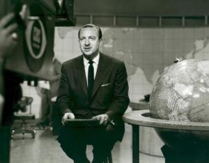 American broadcast journalist Walter Cronkite broadcasts the news on the CBS Morning Show, New York, New York, March 4, 1954. He sits on a stool next to a large globe, while a world map is visible on the wall in the background. (Photo by CBS Photo Archive/Getty Images)