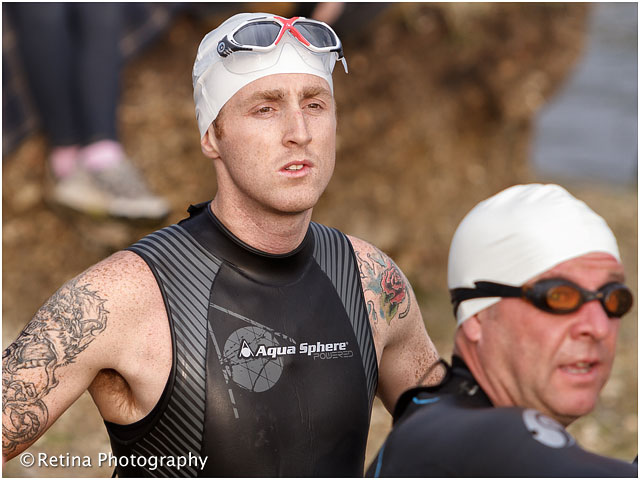 Triathlon Swimming Competitor Waiting to Enter the Water