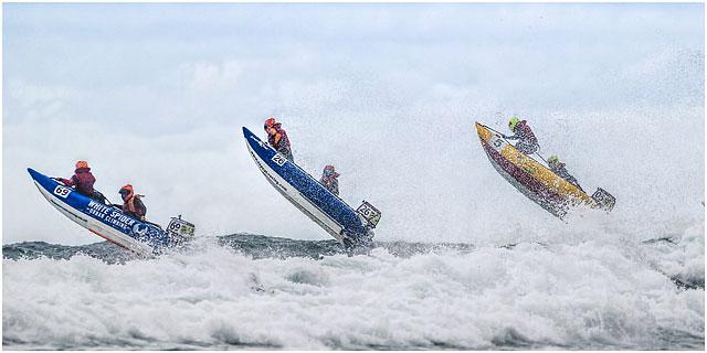 Action Shot Of Three Zapcat Powerboats In Mid Flight