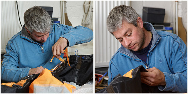 Portrait Of Male Sailmaker With Blue Top Repairing Sails By Hand In Workshop