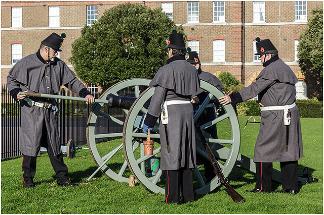 Priming Three Pounder Cannon For Firing at 2014 Remembrance Day Service