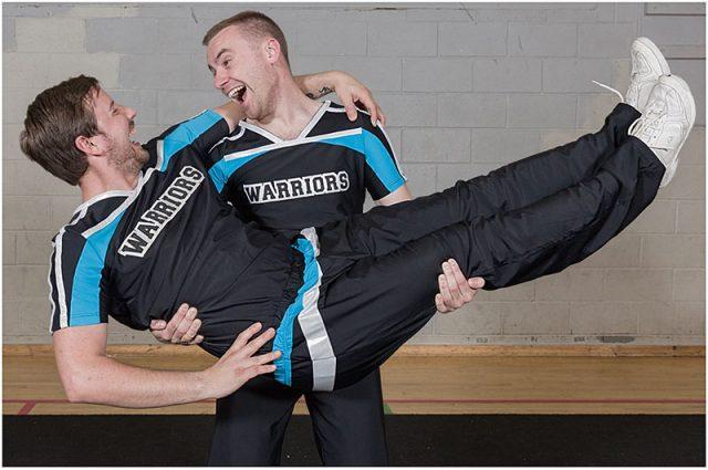 two male portsmouth warriors cheerleaders having a joke