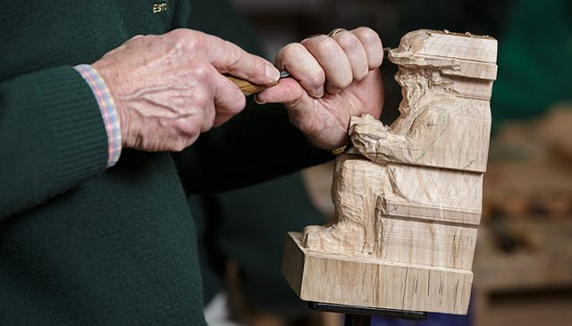 solent woodcarver carving a figurine