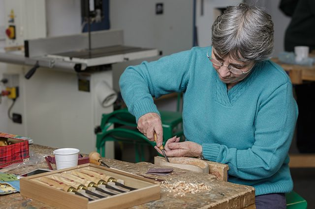 female woodcarver with personal carving project