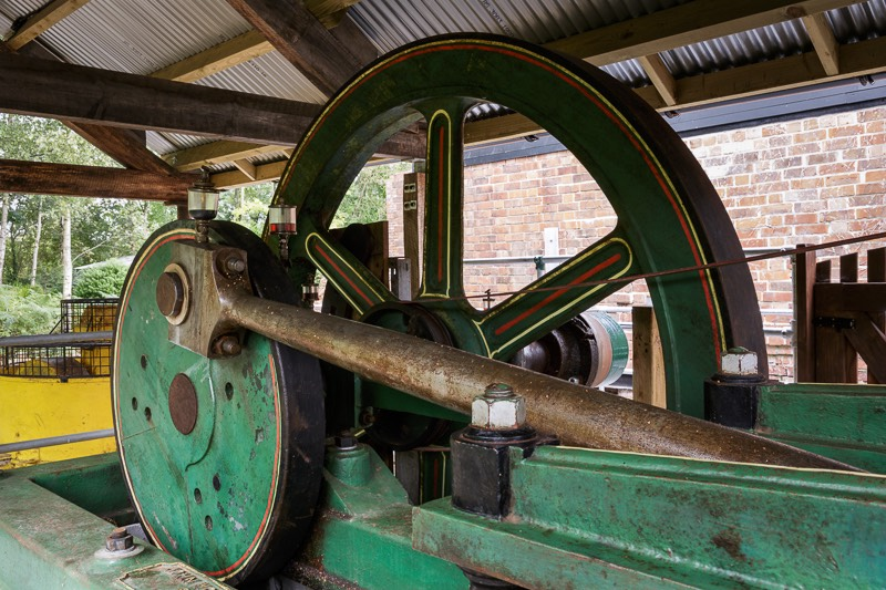 Closeup of fly wheel and Number two John Wood steam engine piston at bursledon brickworks museum