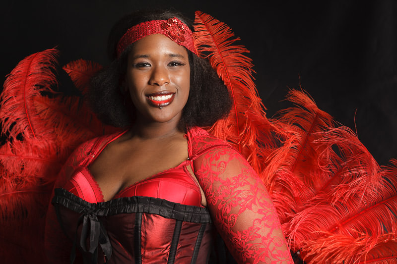 informal portrait of burlesque performer in red outfit