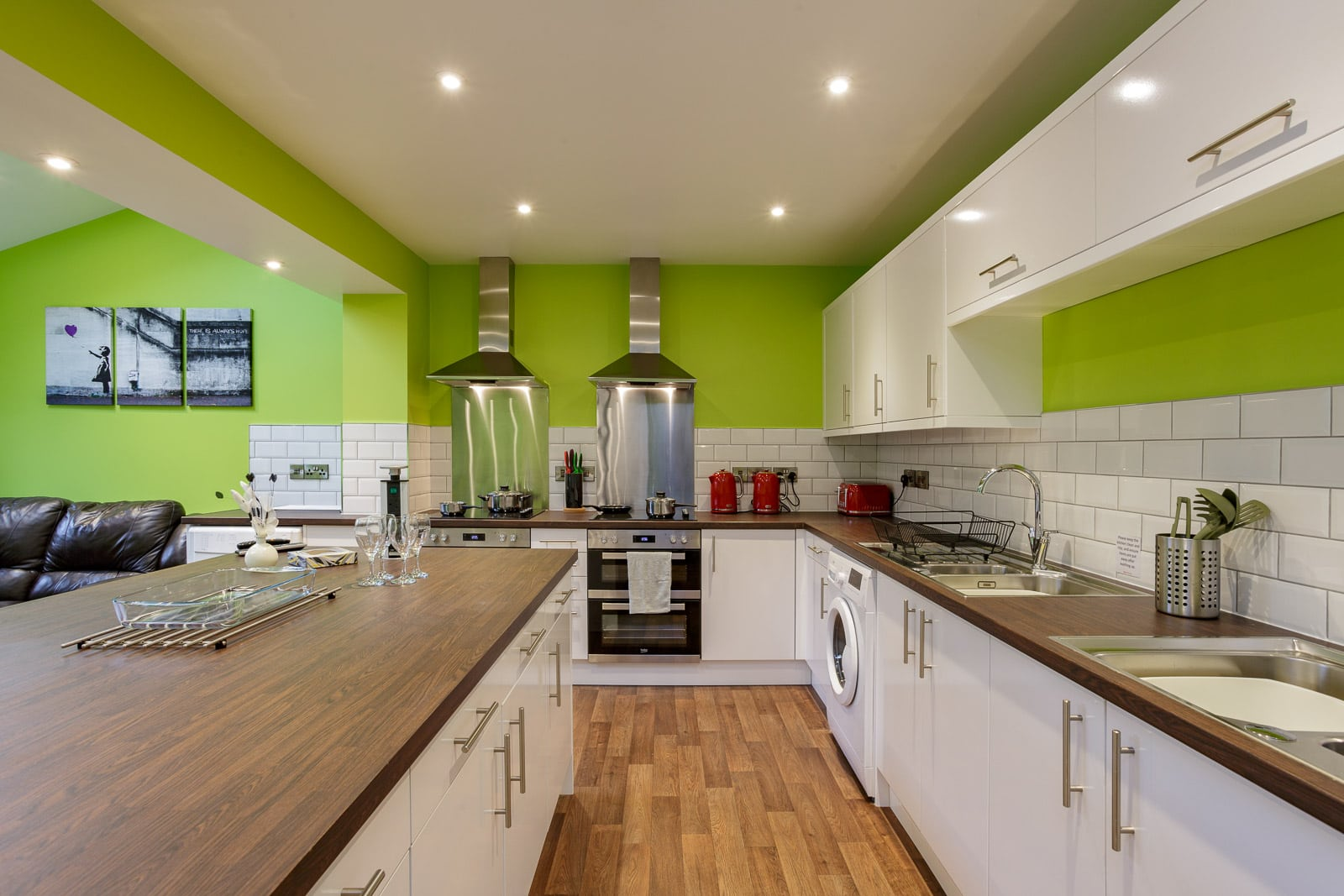 bright green and white modern kitchen in an upmarket HMO [house of multiple occupancy]
