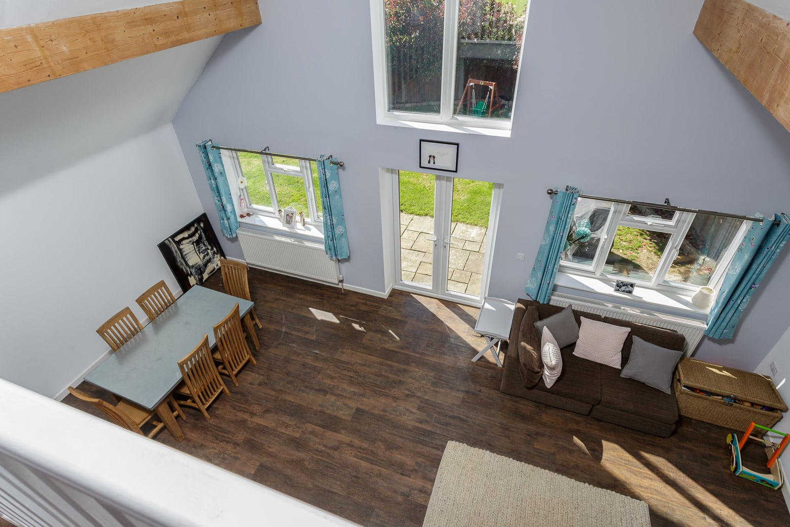 View looking down into spacious living area from first floor balcony of a refurbishment project