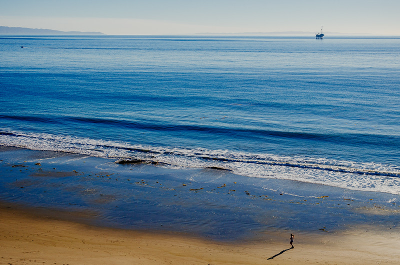 Jogger and Santa Barbara Channel with oil rig.