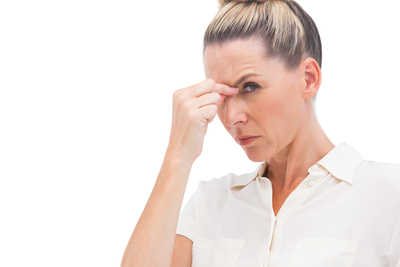 Businesswoman having headache on a white background