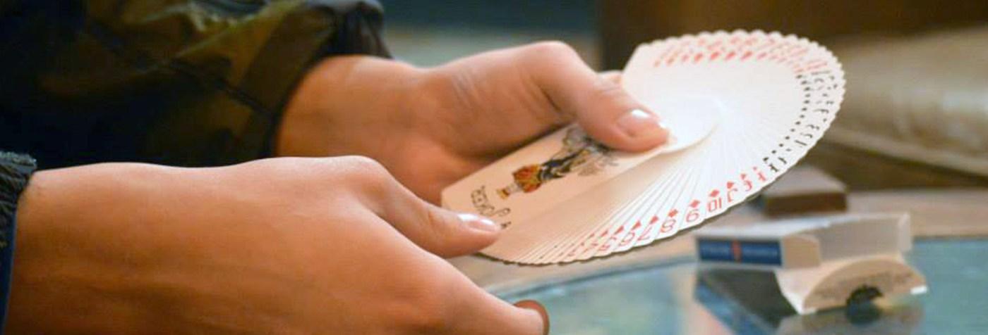 Magician Steven Brundage fans a deck of cards