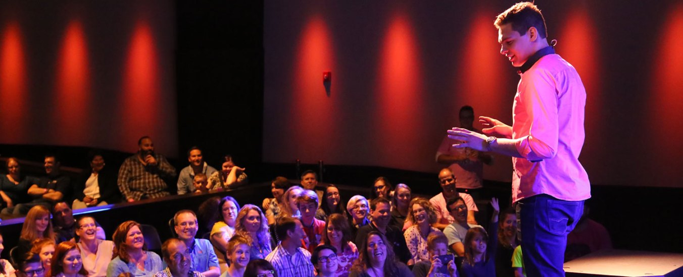 Magician Steven Brundage performing for a crowd