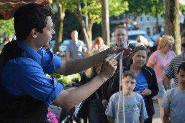 Magician Steven Brundage performing rope magic