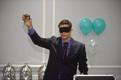 Magician Steven Brundage prepares to solve a Rubik's Cube while blindfolded