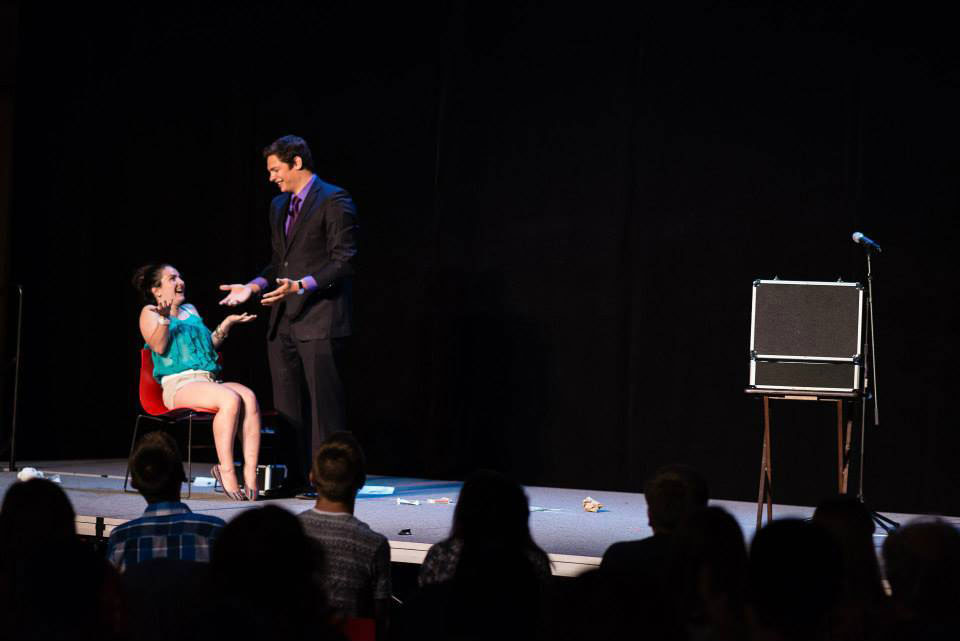 College Magician Steven Brundage performing stage magic at a college