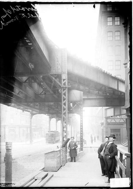 Photograph showing the elevated stub track on Market Street. The view is looking east along Lake Street at Market Street, where the elevated train would turn south.