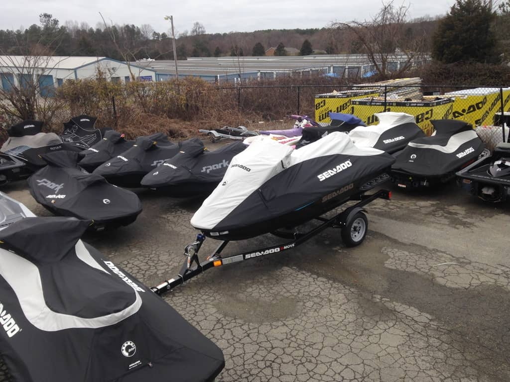 group of jet skis with covers