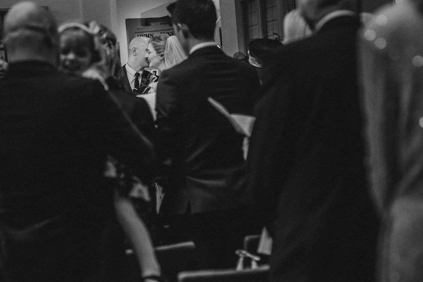 moment between the bride and groom in church