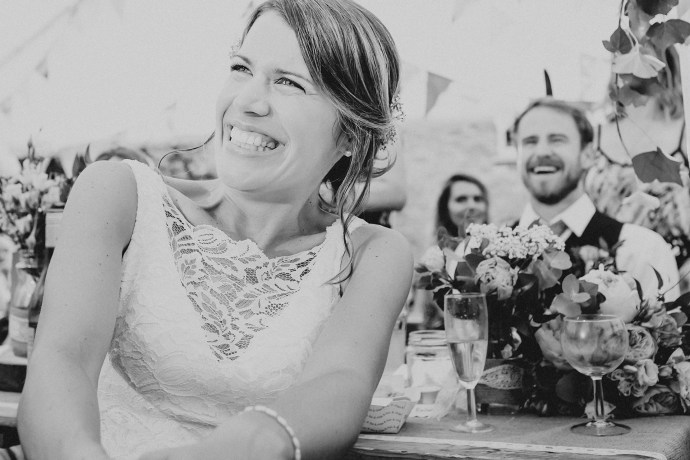 bride and groom laughing in the speches, lots of emotion here.