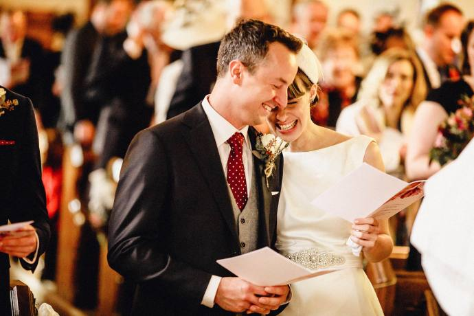 lovely photo of the bride and bridegroom laughing during the ceremony