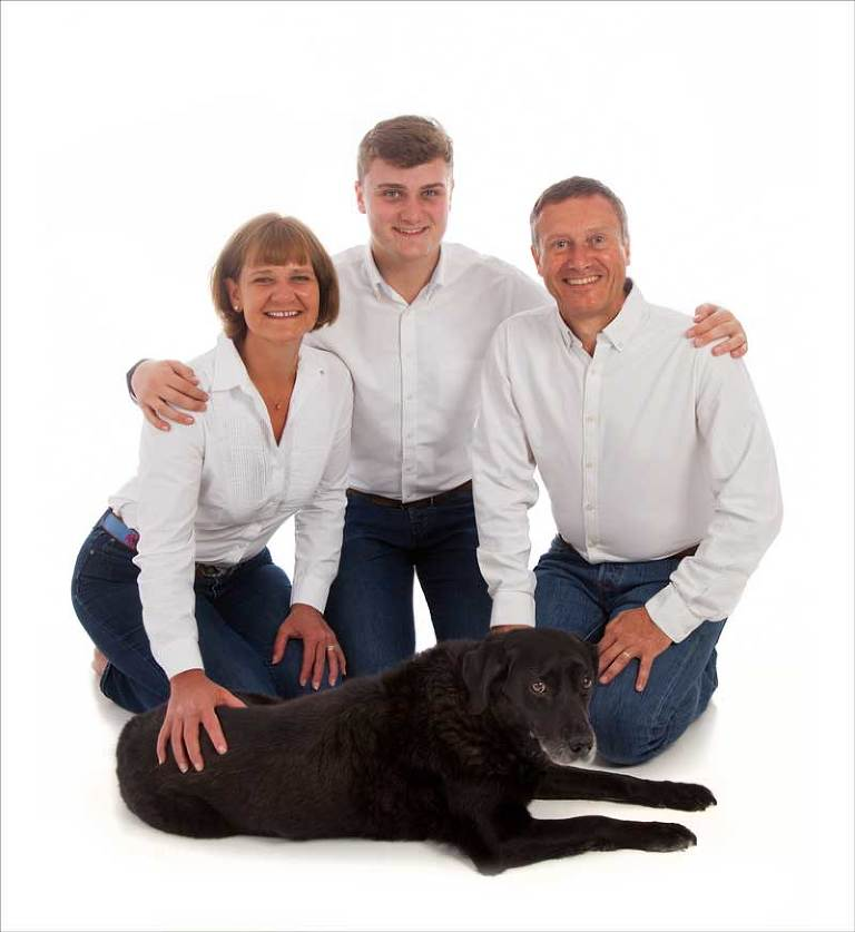 Family photo with pet labrador
