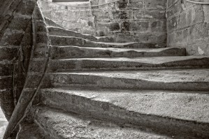 Worn stairs in the Grand Staircase of the Château-Vieux, Lourmarin, France.