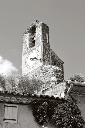 17th century belfry and clock, built on the remains of an ancient Feudal castle, in the village of Lourmarin, France.