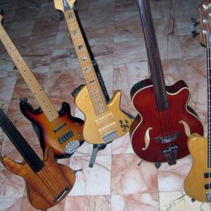 Left to Right - 2003 Rob Allen MB2 with Deep 5 neck, 2003 Lakland Skyline 55-02,2003 Fodera Emperor Elite II, Takamine TB10, 2009 Fodera Imperial Elite Essence .